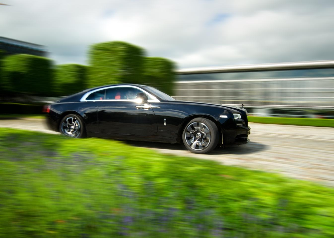 The Rolls-Royce Wraith on the move outside the brand's Goodwood factory
