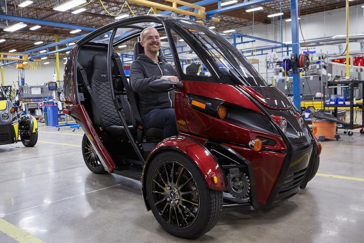 Arcimoto's founder and president Mark Frohnmayer prepares the first FUVs for delivery to customers