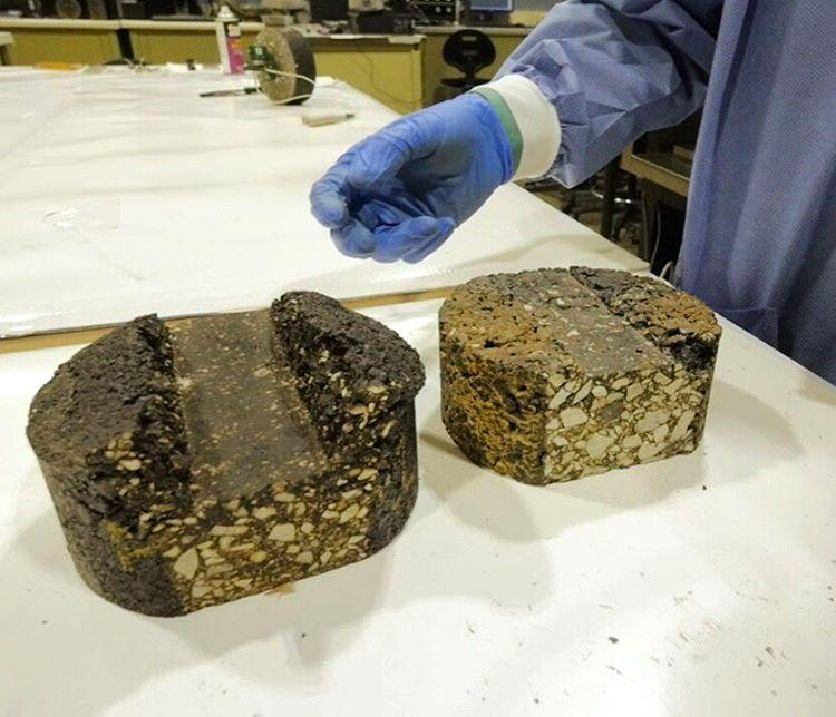 Chunks of asphalt made with binders derived from pig manure, which can replace the petroleum found in traditional asphalt