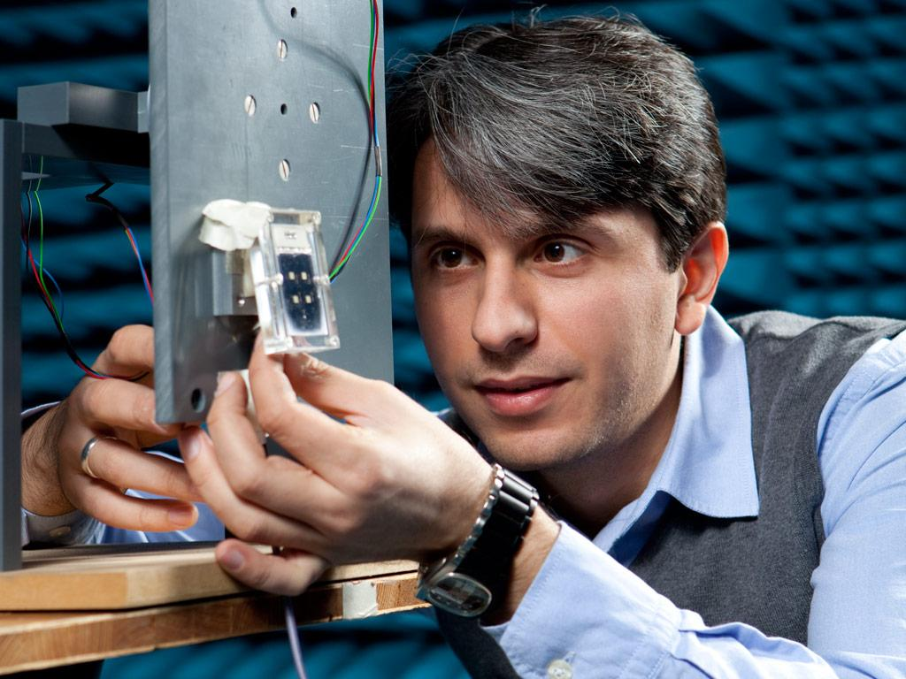 Onur Hamza Karabey and his prototype liquid crystal antenna