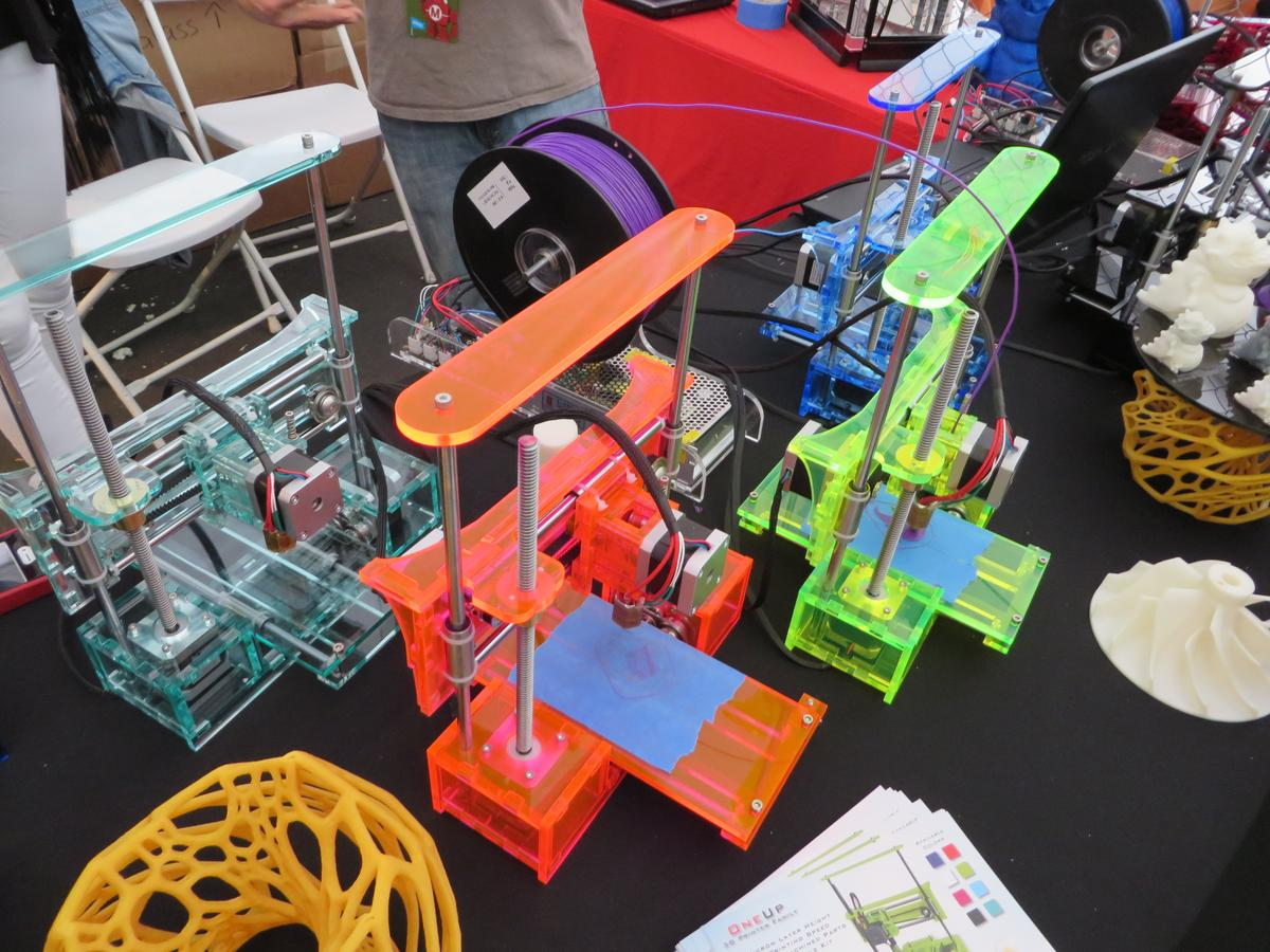 Assorted QU-BD printers on display at Maker Faire