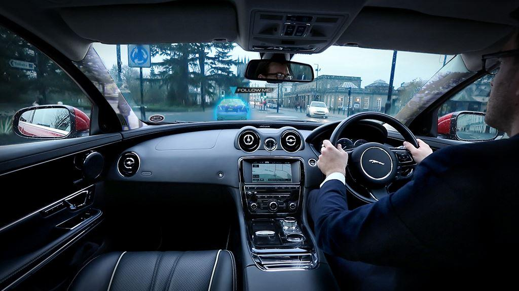 """Jaguar Land Rover is researching the use of vehicle roof support pillars as """"see-through"""" screens and a head-up display ghost car for navigation"""