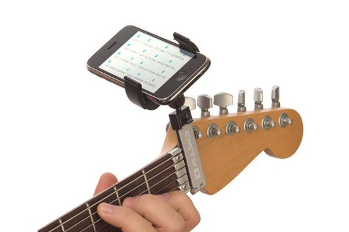 The Guitar Sidekick portable device mount places a smartphone or media players at the end of a guitar's fretboard for comfortable viewing of music notation, tabs, lyrics and so on