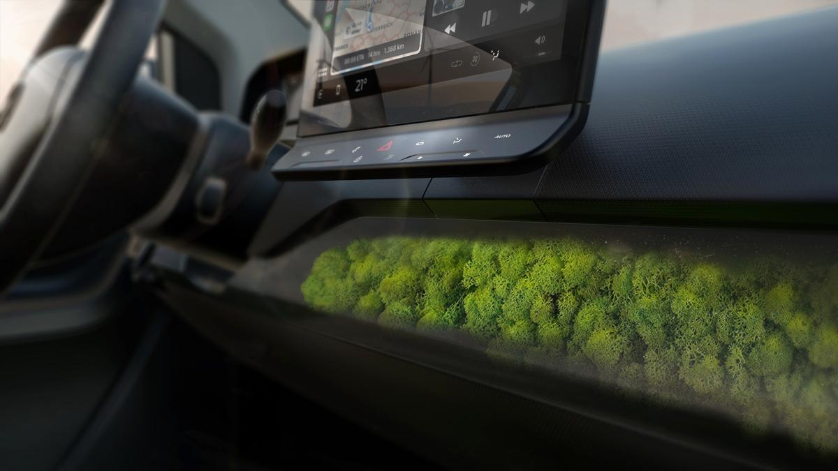 A 10-inch infotainment system display sits above a natural air filter inside the Sion