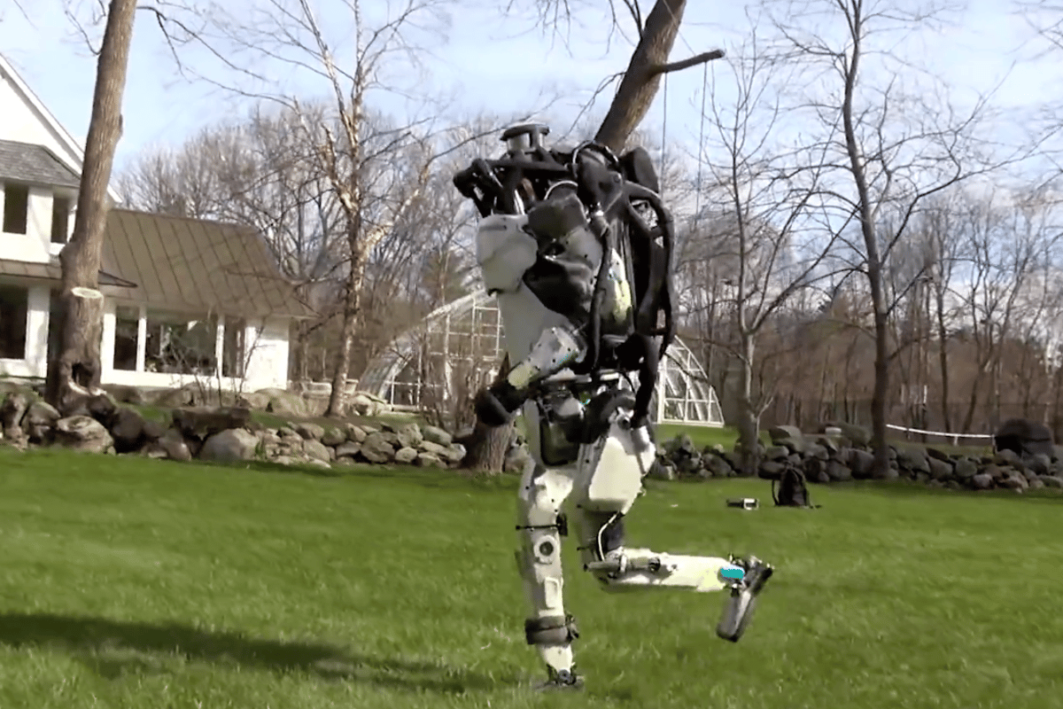 Boston Dynamic's humanoid Atlas robot is shown taking a  jog through the woods in a new video