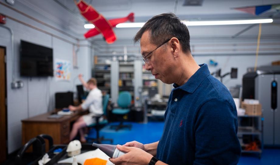 "U Virginia engineering research scientist Jianzhong ""Joe"" Zhu assembles the Tunabot"