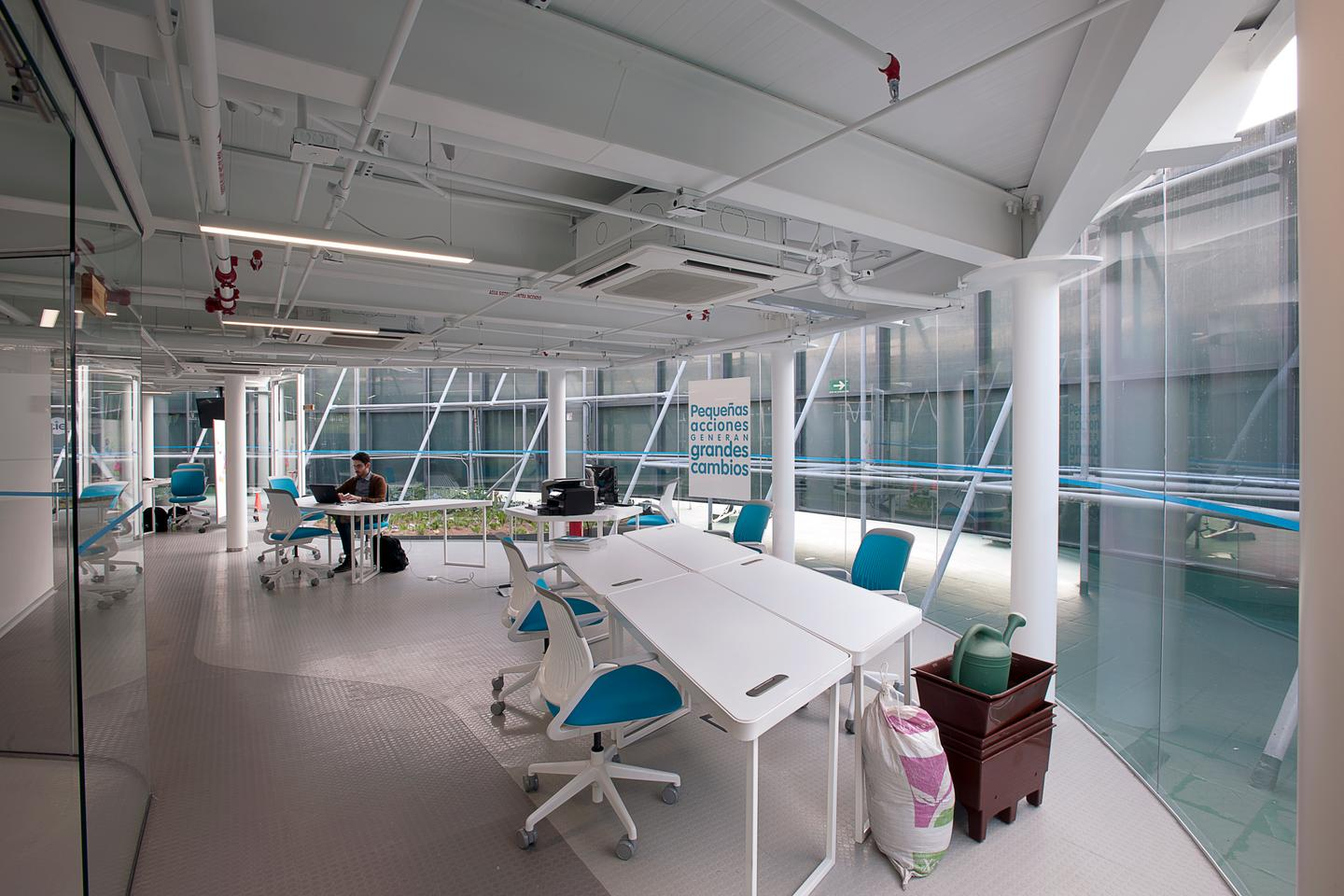 The designers built an open office space filled with locally-made furniture that's designed to be easily rearranged into different configurations (Credit: Jaime Navarro; Courtesy Rojkind Arquitectos)