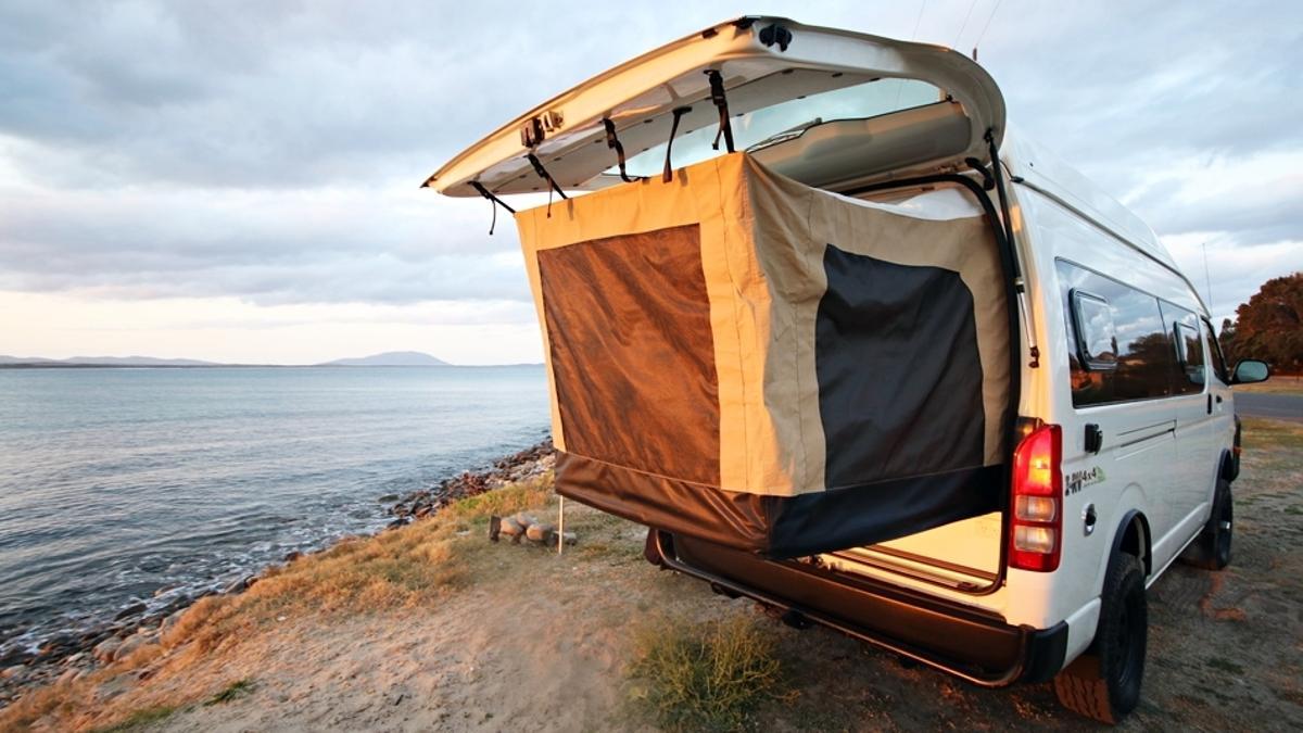 The Bus 4x4 Hiace Commuter camper van islike an automotive swag