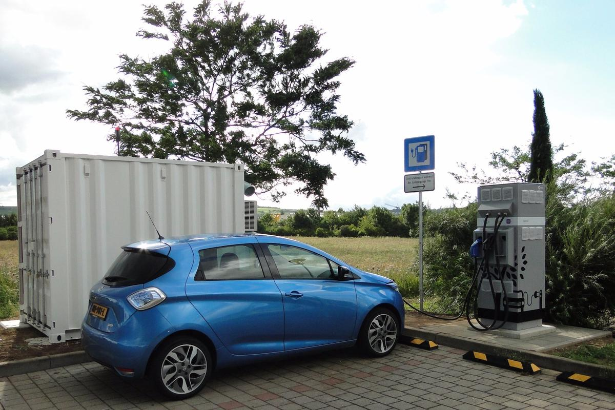 A Renault Zoe getting a quick charge from a station that uses second-life Renault EV batteries