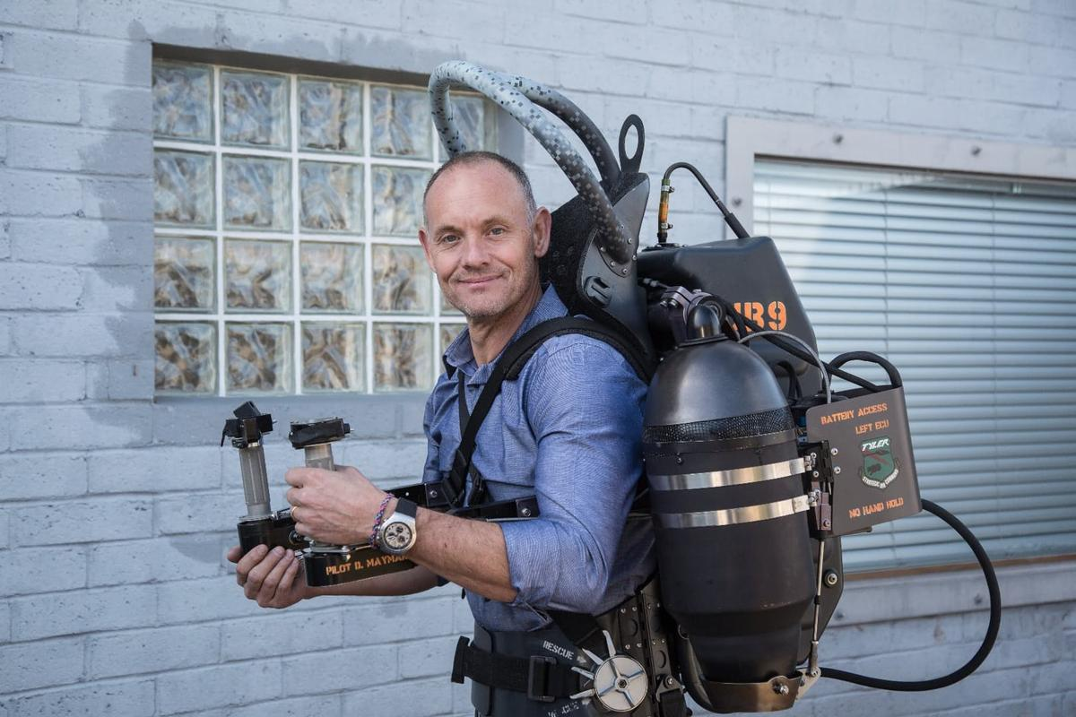 Jetpack Aviation CEO David Mayman with the older model JB-9 jetpack