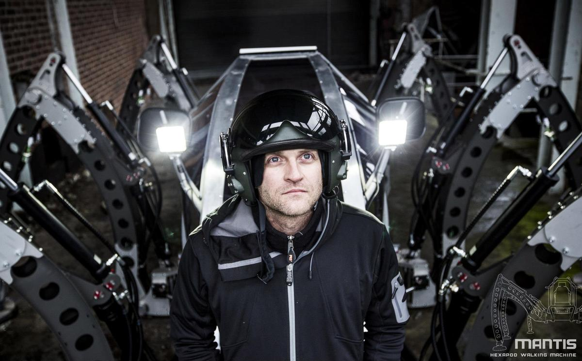 Matt Denton, chief designer and founder of Micromagic Systems, sits in the cockpit of his giant hexapod robot Mantis