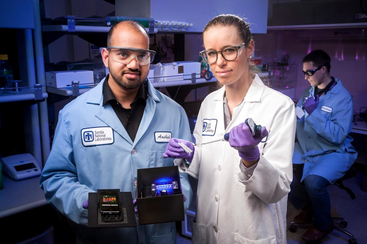 Researchers Aashish Priye, Sara Bird and Cameron Ball, of Sandia National Laboratories, who worked on the low-cost Zika detection test device