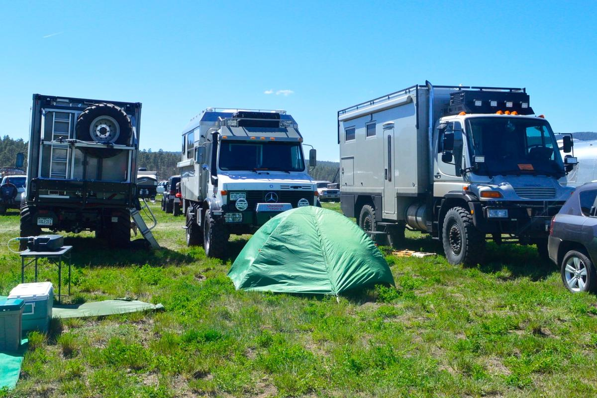 Serious expedition trucks in the Overland Expo camping lot