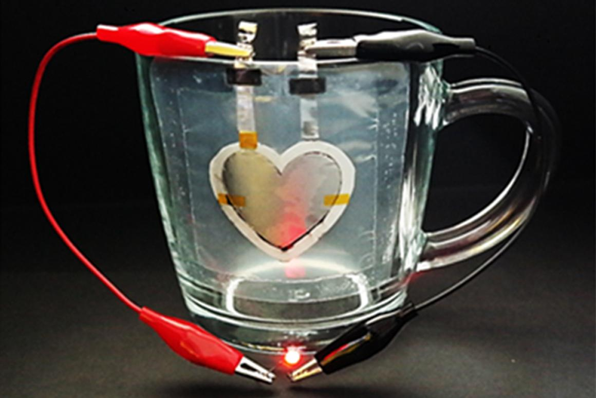 The heart-shaped battery printed onto a glass cup is capable of powering an LED