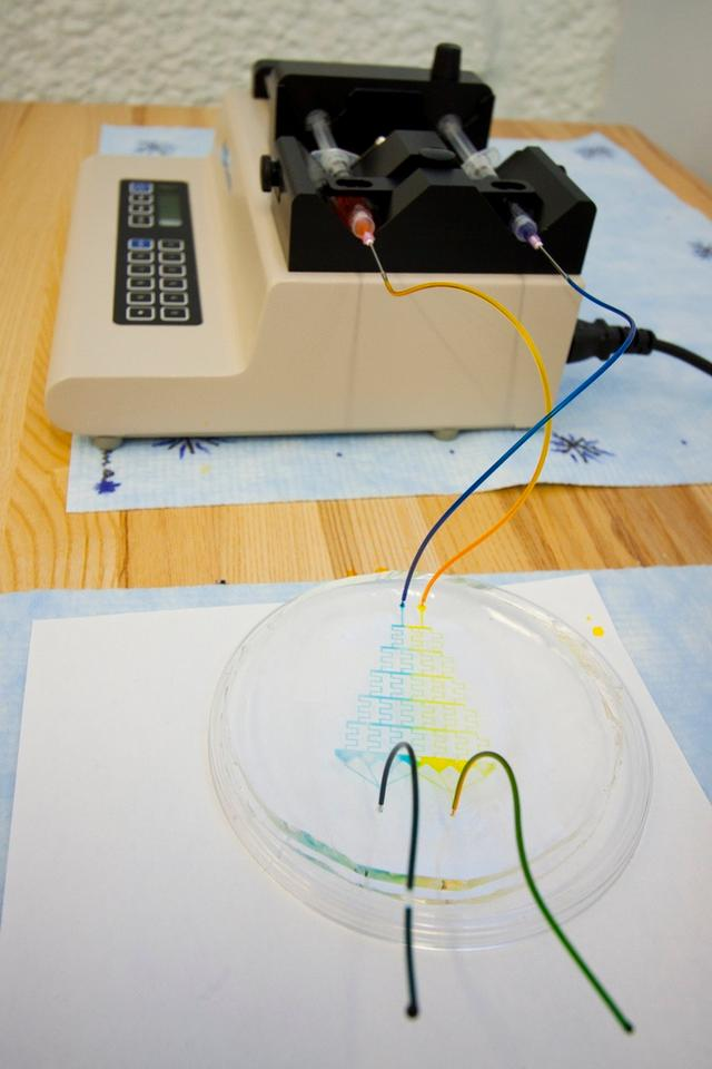A high school physics teacher has invented a method of producing microfluidic devices, using little else than a photocopier and transparency film
