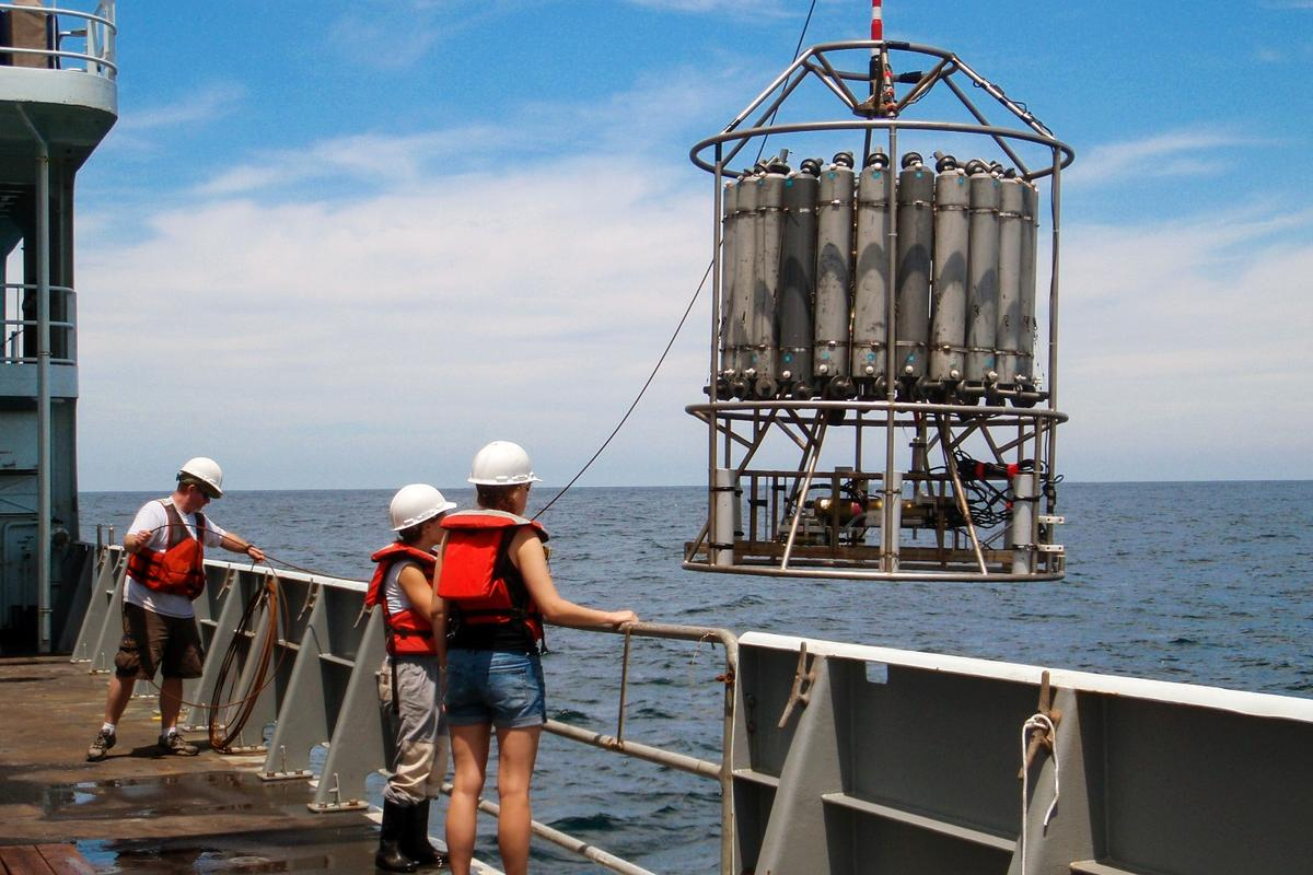 Researchers pictured with one of the sampling devices used to collect readings of the Pacific Ocean