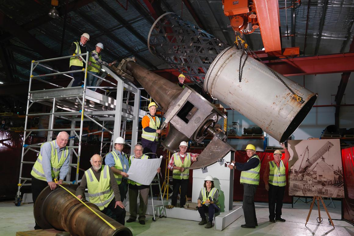 Volunteers and staff with components of the Great Melbourne Telescope at Moreland Annexe