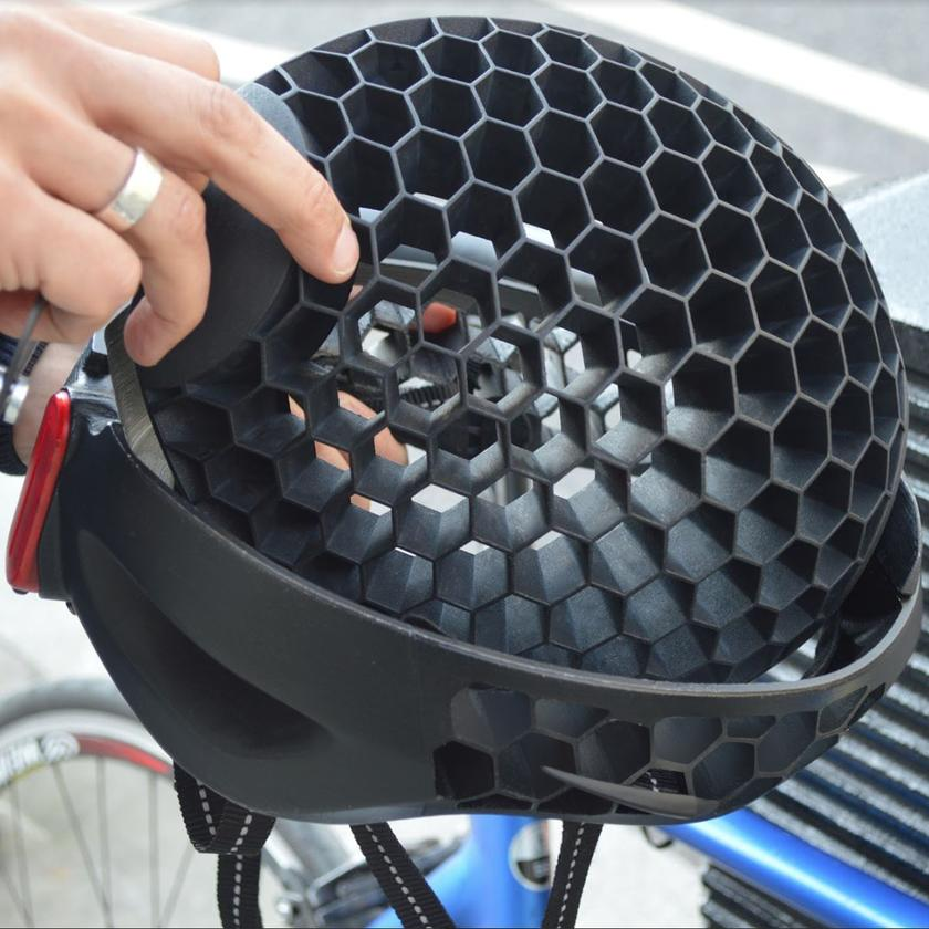"""The top """"dome"""" part of the Cyclo swivels around laterally (it pivots at the front and back), so it nests upside-down within its bottom section"""