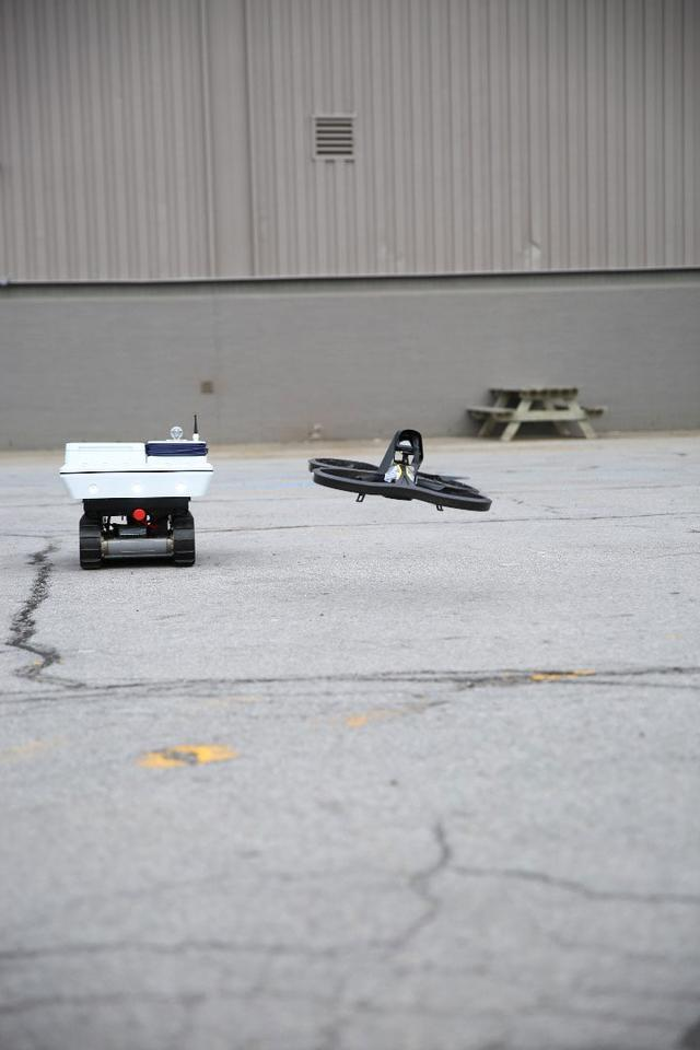 GE robotic rover working in collaboration with a drone