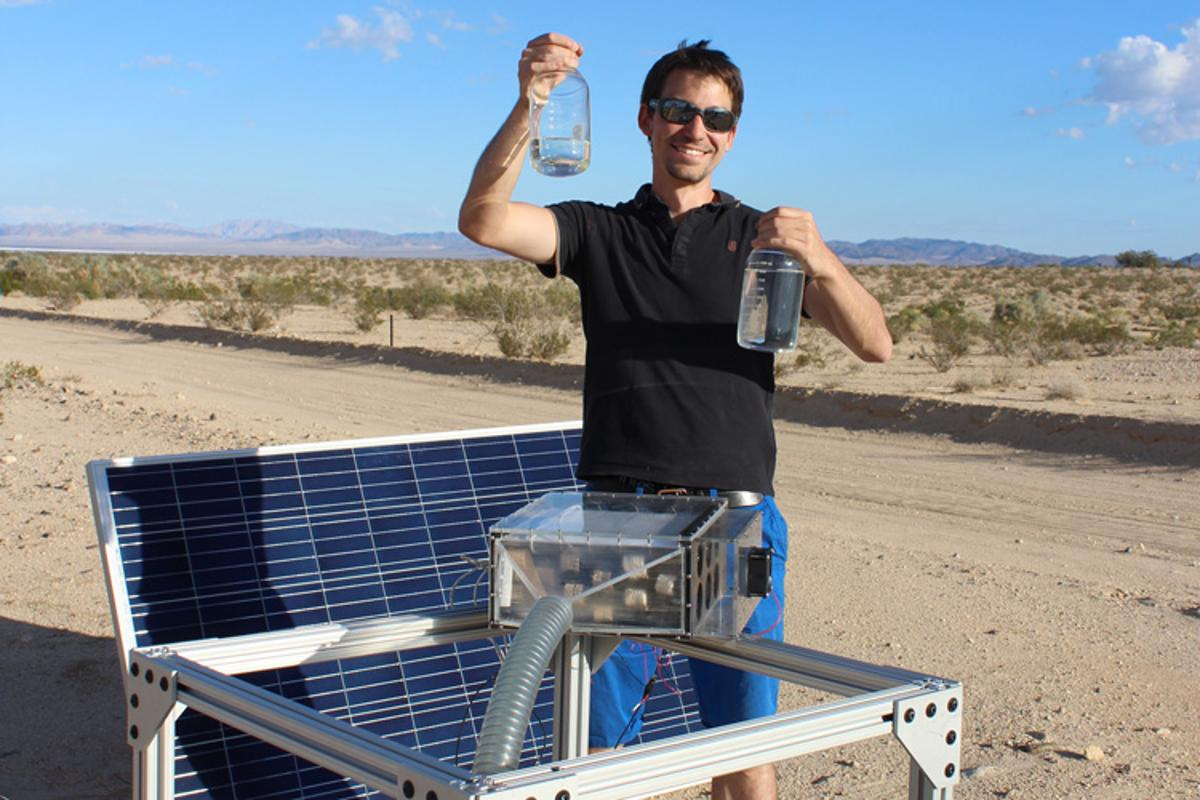 Researcher Mathieu Prévot with water collected from the new device that can wring water out of even very dry air