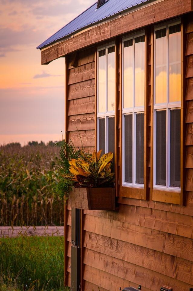 The tiny house sports cedar siding