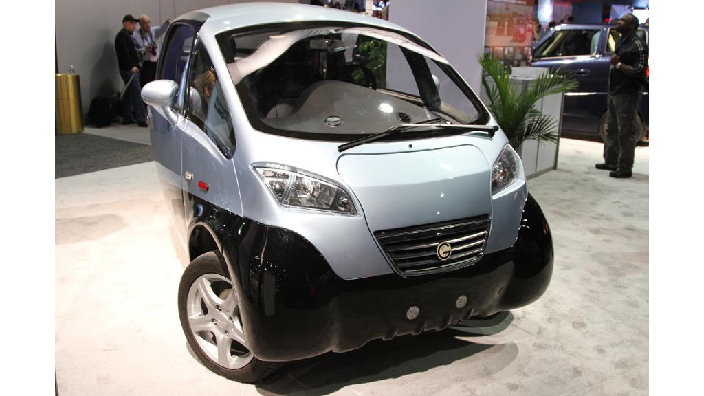 The TRIAC three-wheeled electric vehicle competes with regular gas-powered cars on performance and price