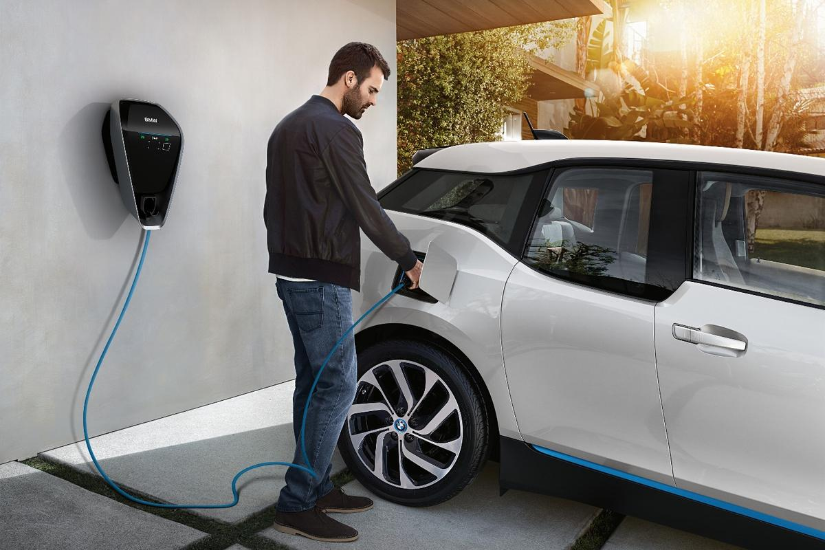 The BMW i3 being charged up using the new smart charging system