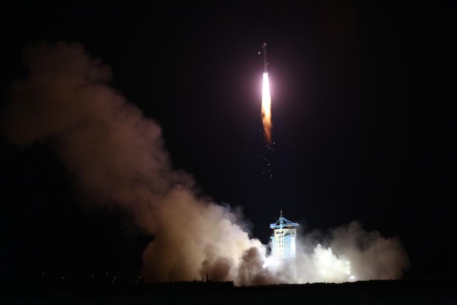 The QUESS satellite being launched on a Long March-2D rocket