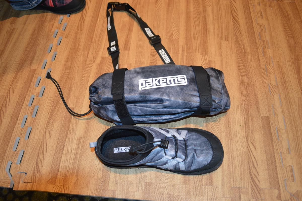 The two Pakems shoes pack into the included carry bag