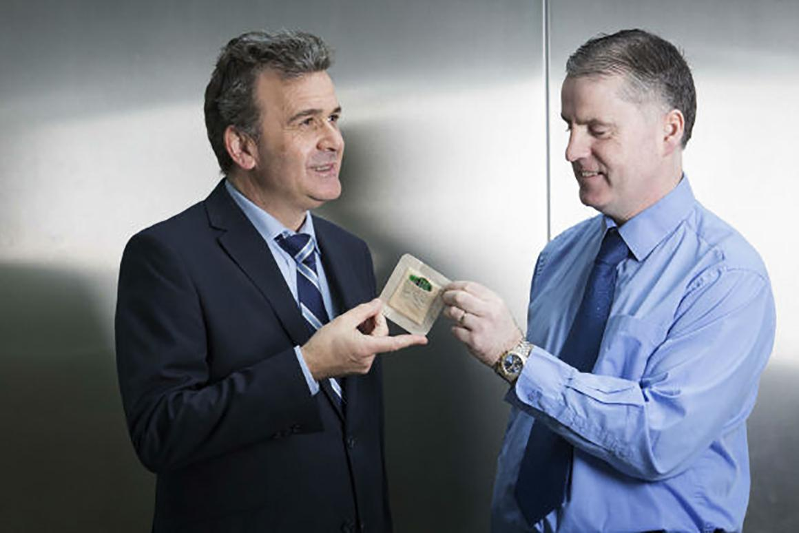 The smart dressing is designed to monitor wounds so doctors don't have to make repeated visual inspections (it's seen here with Fleming Medical CEO Mark Fleming and the Tyndall National Institute's Dr. Paul Galvin)