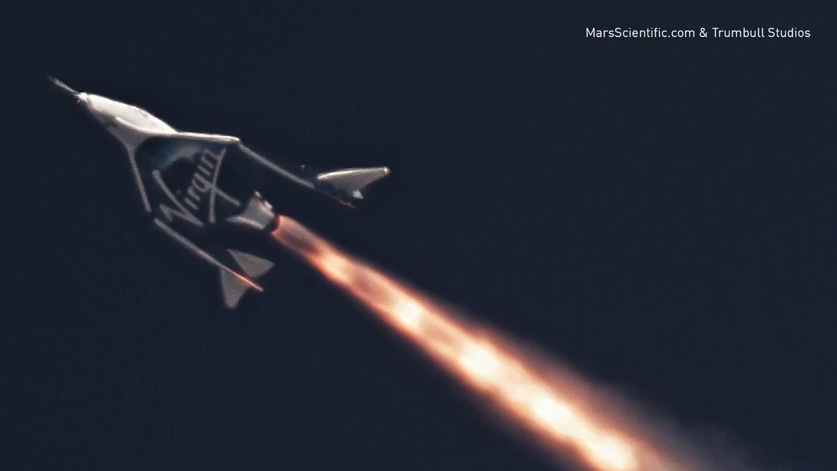 Virgin Galactic's tourist-carrying spaceplane's chemical rocket engine was fired for the first time today in the skies over the Sierra Nevada Mountains in California