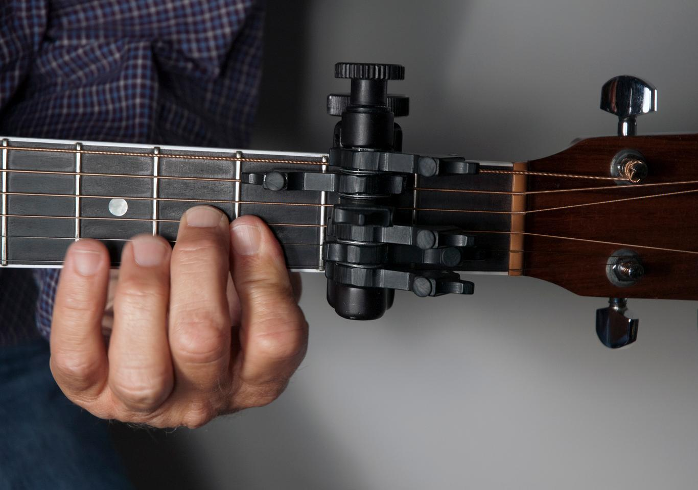 "The CapoSonic works like a ""clamped-on chord,"" allowing your guitar to stay in standard tuning"