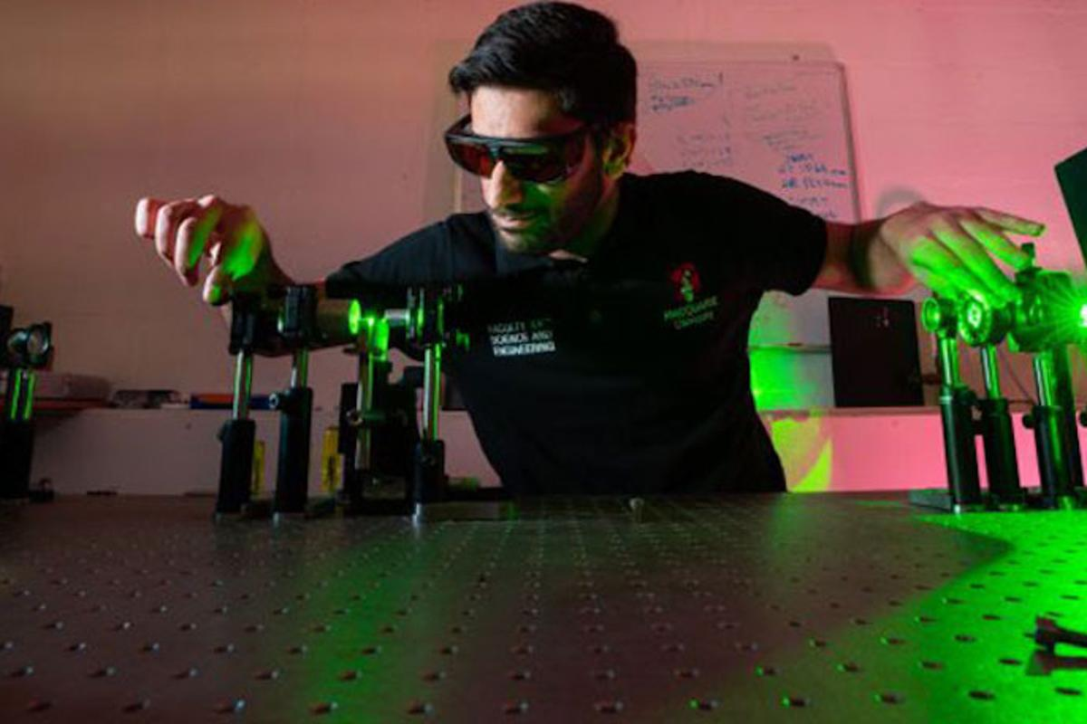 Researcher Seyed Abedi sets up the diamond in the team's quantum-randomized laser
