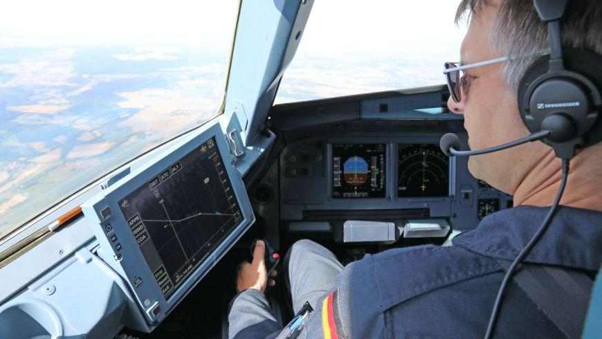 A pilot consults the LNAS display before beginning a landing approach