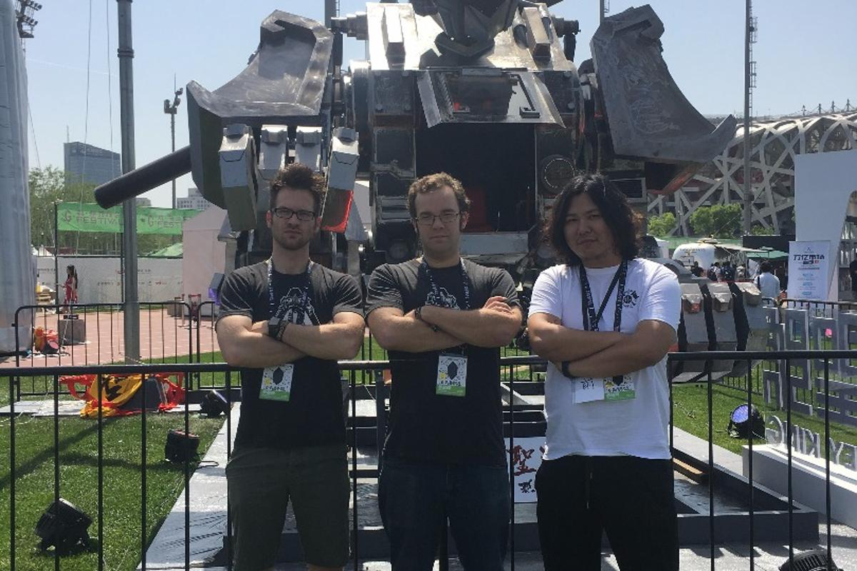 MegaBots co-founders Matt Oehrlein and Gui Cavalcanti with Monkey King creator Shiqian Sun