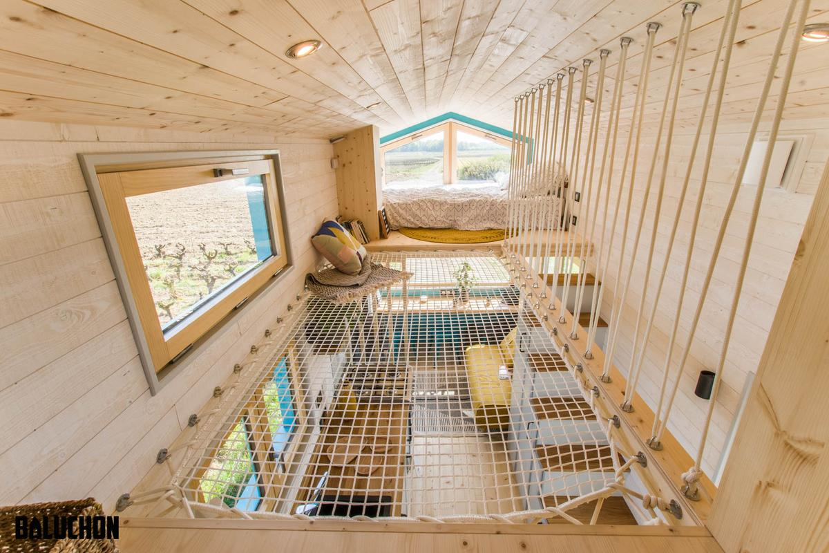 Tiny House Sïana's secondary bedroom is accessed from the main bedroom by using the net