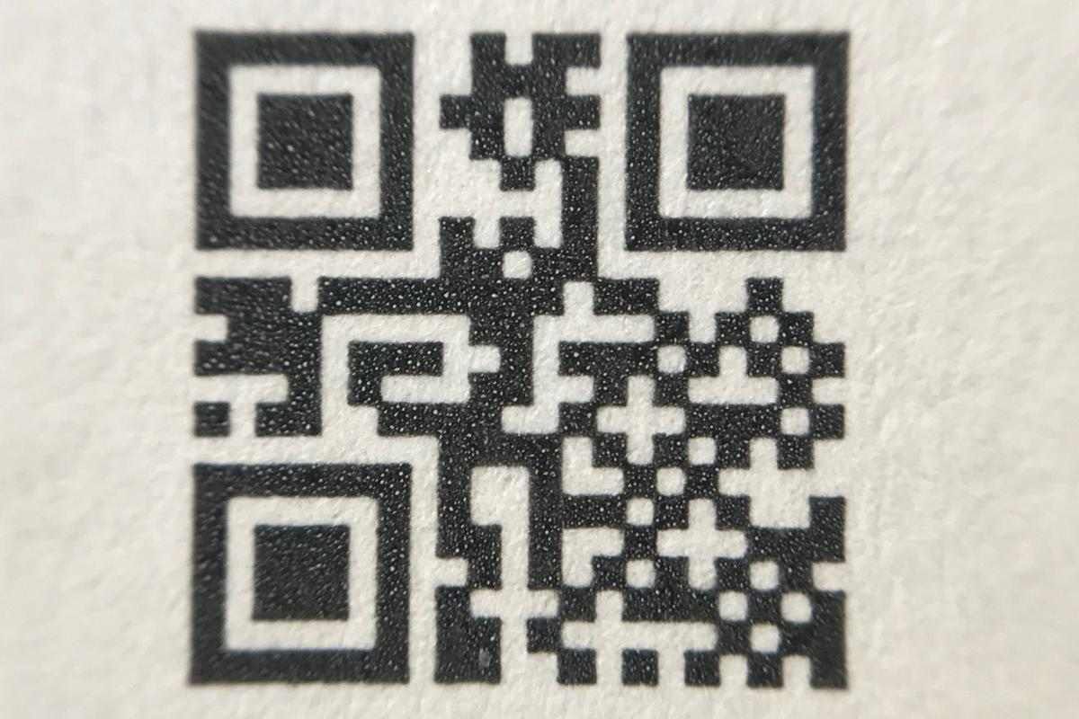 The tags consist of laser-printed QR codes, with random patterns of microparticles sprayed over top