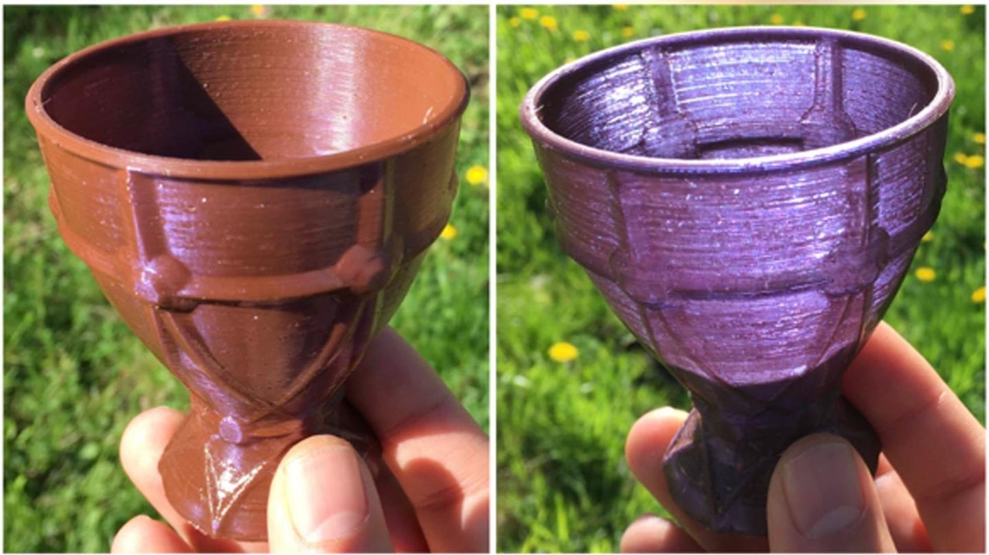 A miniature goblet printed from the new material appears both opaque brown and translucent violet