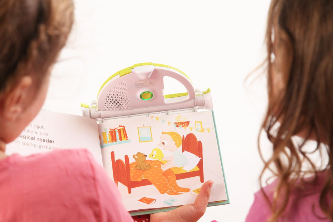 The Sparkup Magical Book Reader is a device which allows children to hear recordings of their parents reading their favorite books to them