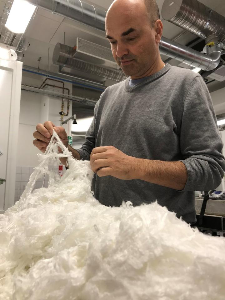 Nanollose founder Gary Cass with the company's plant-free Nullarbor fiber, which is produced using microbes that convert biomass waste into cellulose that's converted into rayon fibers