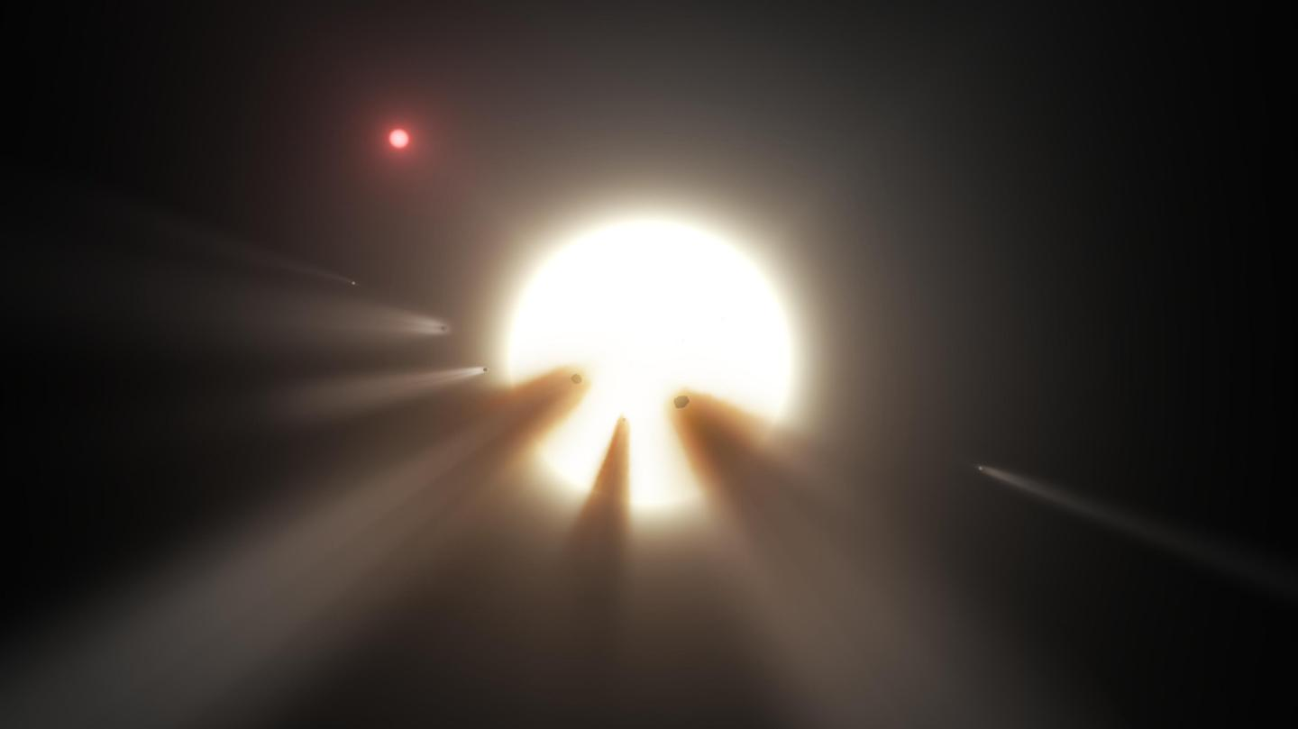 "An artist's impression of a swarm of comets dimming ""Tabby's Star"" – an explanation that has been ruled out for the newly described star, EPIC 249706694"