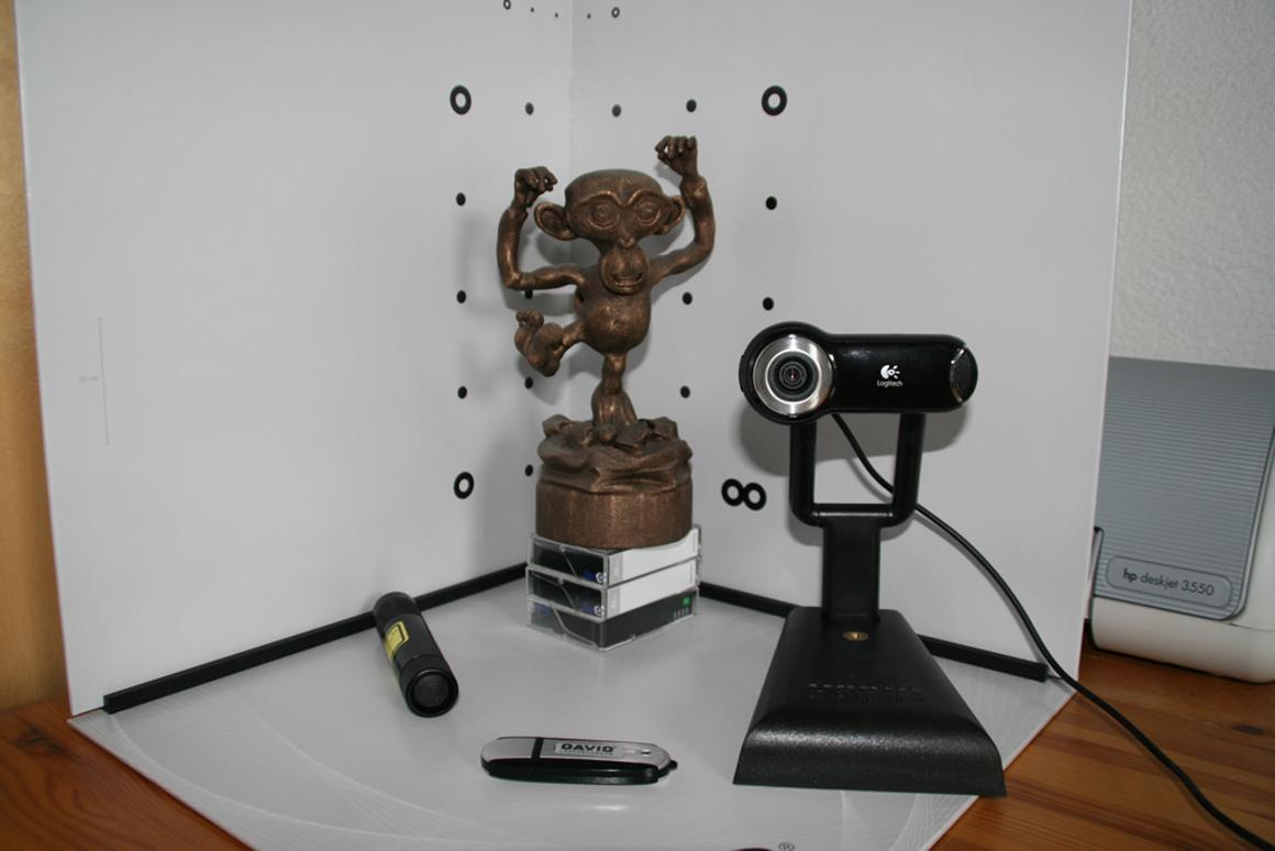 Low-cost 3D-scanning using gray scale camera, laser pen and calibration points