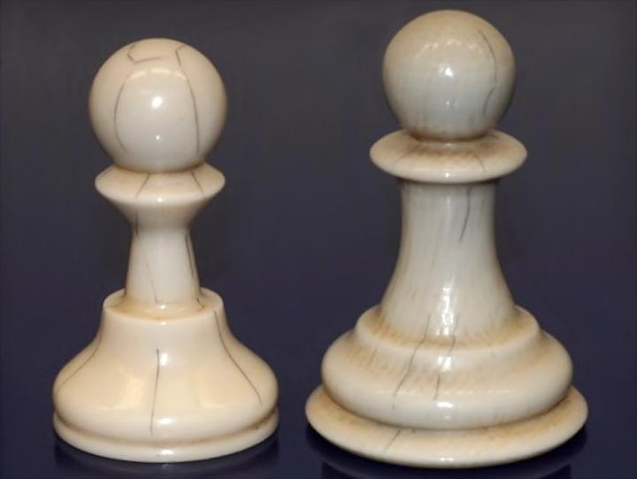 Two chess pawns, both made of Digory