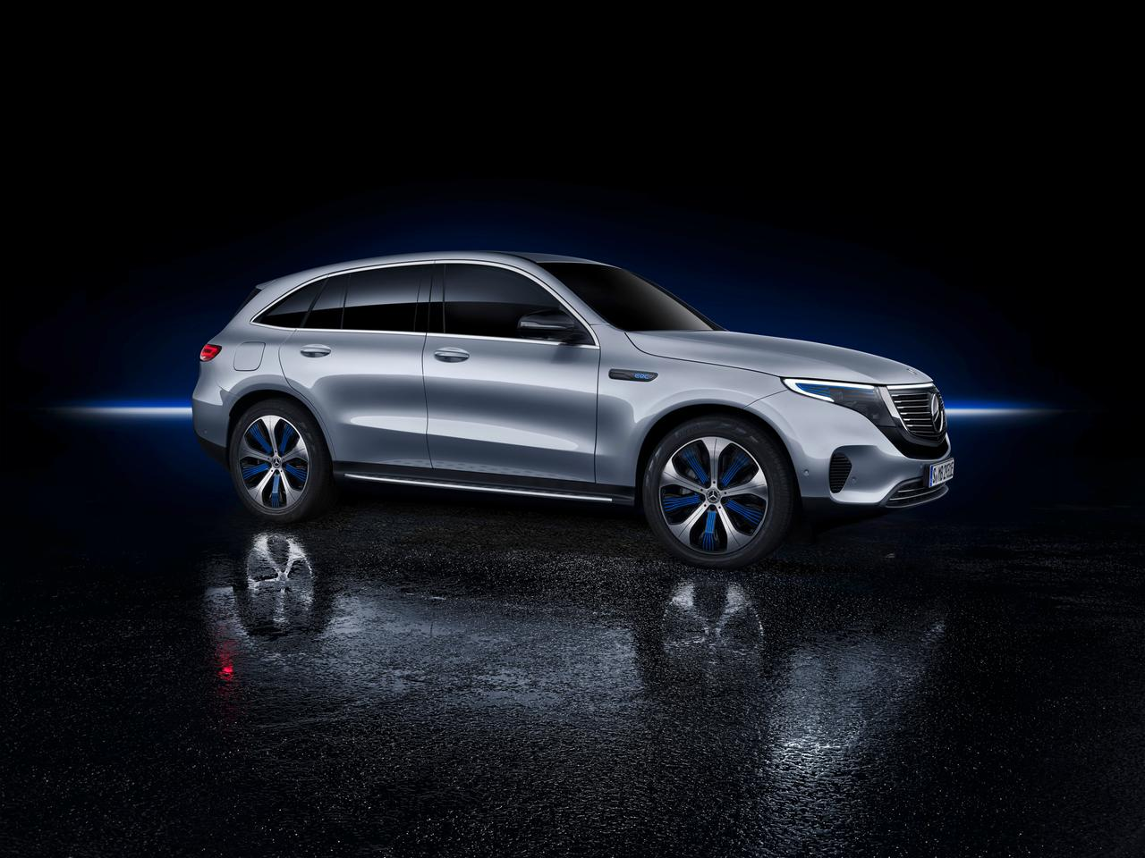 Mercedes-Benz EQC: sleek side profile with electric blue wheel accents