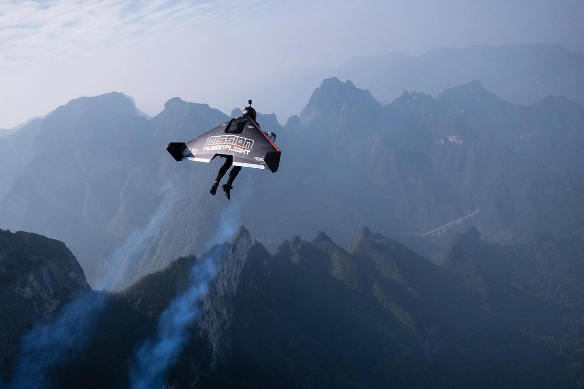 Vince Reffet took this photo of his long-time partner in crime Fred Fugen as the pair flew their Jetman jet wings over the mountains of China