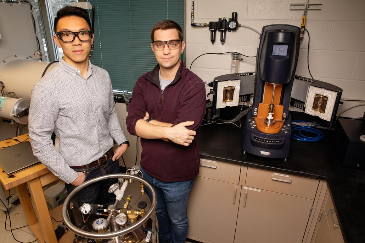 Materials science and engineering professor Christopher Evans, right, and graduate student Brian Jing have developed a solid battery electrolyte that is both self-healing and recyclable