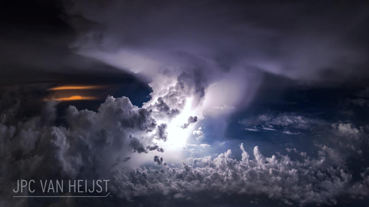 Lightning in the distance captured by airline pilotChristiaan van Heijst