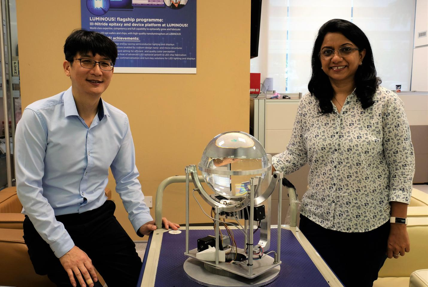 Asst. Prof. Yoo Seongwoo (left) and Dr. Charu Goel with the solar concentrator
