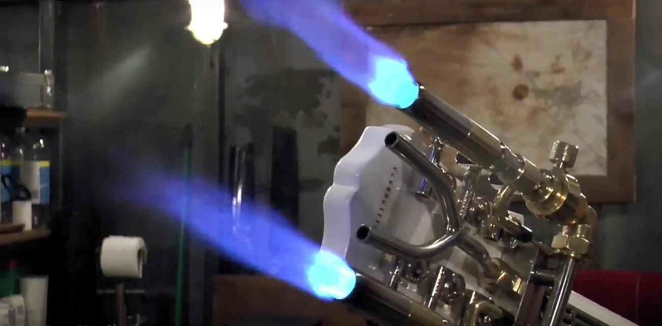 The customized blow torch heads mounted to the back of the guitar's headstock