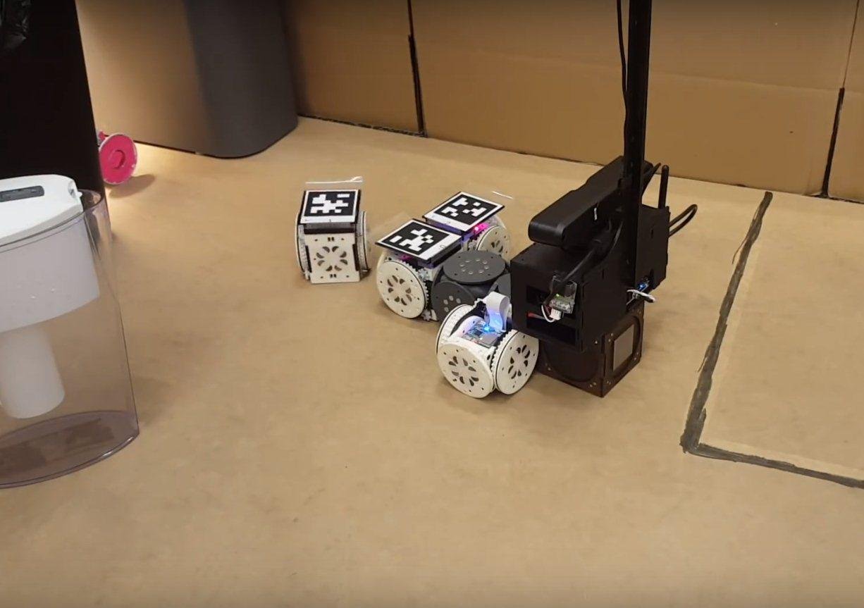 In one experiment, the modular robot system was tasked with finding and retrieving a pink object, and then delivering to a designated dropoff zone